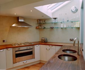 Modern kitchen with dual sinks and Duropal natural grain worktops