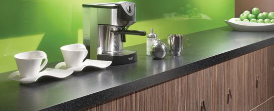 Black kitchen worktop with green kitchen decor