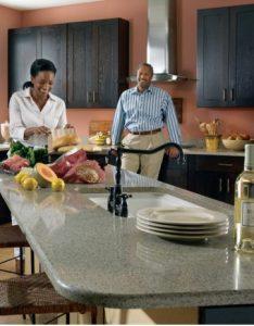 Cooking couple enjoying Zodiaq quartz worktops